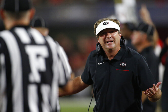 Georgia coach Kirby Smart speaks with the ref in the second half of a NCAA football game between Georgia and Notre Dame in Athens, Ga., on Saturday, Sept. 21, 2019. Georgia won 23-17. [Photo/Joshua L. Jones, Athens Banner-Herald]/Athens Banner-Herald via AP)NCAA college football game Saturday, Sept. 21, 2019, in Athens, Ga. (Joshua L. Jones/Athens Banner-Herald via AP)