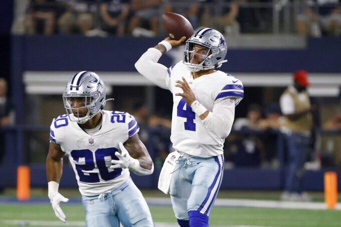 Dallas Cowboys running back Tony Pollard (20) runs a route as quarterback Dak Prescott (4) throws a pass in the first half of an NFL football game against the Philadelphia Eagles in Arlington, Texas, Monday, Sept. 27, 2021. (AP Photo/Ron Jenkins)