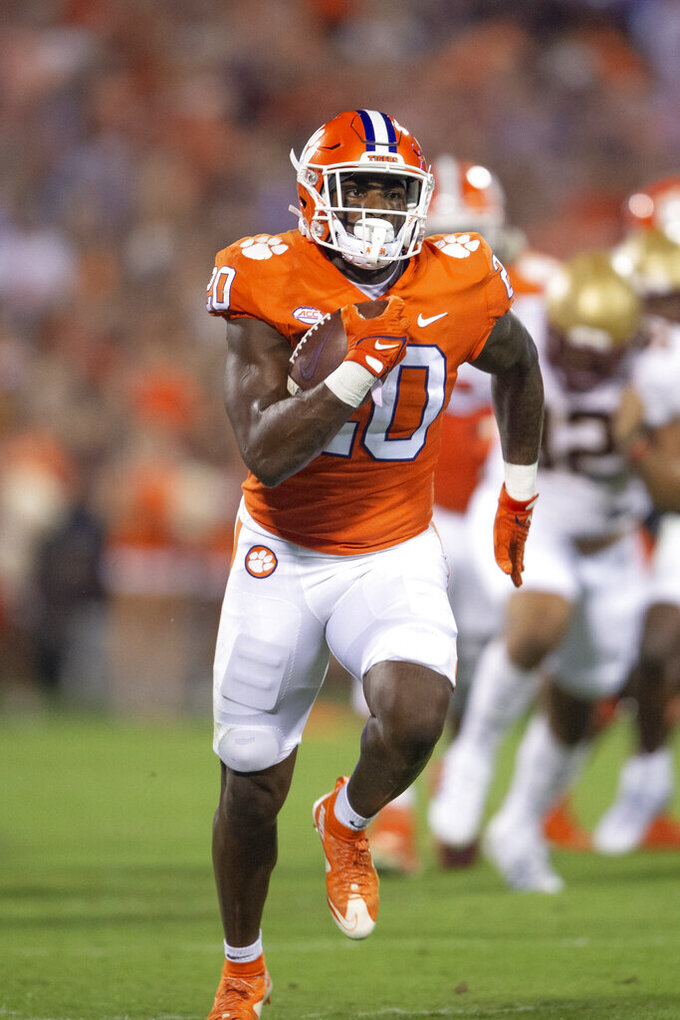 Clemson running back Kobe Pace (20) runs for a 59 yard touchdown during the half of an NCAA college football game, against Boston College. Saturday, Oct. 2, 2021, in Clemson, S.C. (AP Photo/Hakim Wright Sr.)
