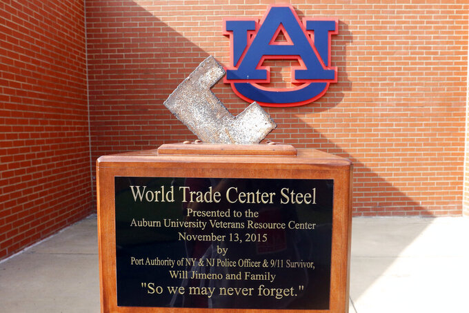 A piece of the World Trade Center is on display in the end one before the kickoff of an NCAA football game between Auburn and Alabama State Saturday, Sept. 11, 2021, in Auburn, Ala. (AP Photo/Butch Dill)