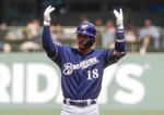 Milwaukee Brewers' Keston Hiura celebrates after hitting an RBI double during the sixth inning of a baseball game against the Atlanta Braves Wednesday, July 17, 2019, in Milwaukee. (AP Photo/Morry Gash)