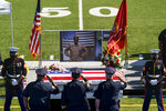 Law enforcement members salute the casket of Sgt. Johanny Rosario Pichardo, a U.S. Marine who was among 13 service members killed in a suicide bombing in Afghanistan, during a public wake at Veterans Memorial Stadium in her hometown of Lawrence, Mass., Tuesday, Sept. 14, 2021. (AP Photo/David Goldman)