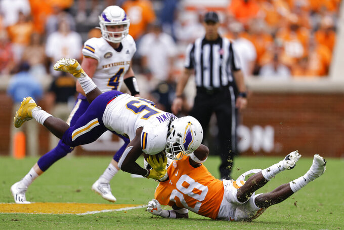 Tennessee Tech running back Jordan Brown (45) is tackled by Tennessee defensive back De'Shawn Rucker (28) during the second half of an NCAA college football game Saturday, Sept. 18, 2021, in Knoxville, Tenn. Tennessee won 56-0. (AP Photo/Wade Payne)