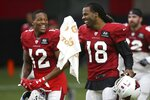 Arizona Cardinals wide receivers Kevin White (18) and Pharoh Cooper (12) laugh during a break in NFL football training camp Wednesday, July 31, 2019, in Glendale, Ariz. (AP Photo/Ross D. Franklin)