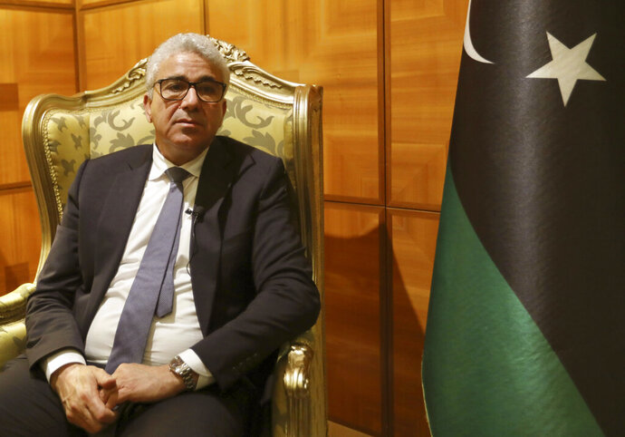 Libya's UN-supported government's interior minister Fathi Bashagha is interviewed on Wednesday, Jan. 6, 2021 in Tripoli Libya.  Bashagha says he hopes that bringing stability to his war-torn country will become a top priority for the Biden administration. Bashagha also told The Associated Press he would be ready to take on the role of prime minister in a yet-to-be-formed unity government.   (AP Photo/Hazem Turkia)