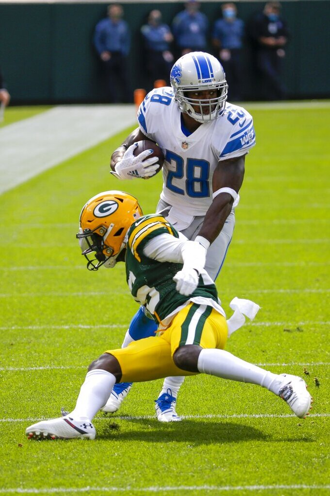 Detroit Lions' Adrian Peterson runs during the first half of an NFL football game against the Green Bay Packers Sunday, Sept. 20, 2020, in Green Bay, Wis. (AP Photo/Mike Roemer)