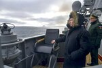Russian President Vladimir Putin watches a navy exercise from the Marshal Ustinov missile cruiser in the Black Sea in Crimea, Thursday, Jan. 9, 2020. The drills involved warships and aircraft that launched missiles at practice targets. (Alexei Druzhinin, Sputnik, Kremlin Pool Photo via AP)