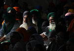 Sikh farmers listen to their leaders speak at Singhu, the Delhi-Haryana border camp for protesting farmers against three farm bills, in New Delhi, India, Wednesday, Jan. 27, 2021. Leaders of a protest movement sought Wednesday to distance themselves from a day of violence when thousands of farmers stormed India's historic Red Fort, the most dramatic moment in two months of demonstrations that have grown into a major challenge of Prime Minister Narendra Modi's government. (AP Photo/Manish Swarup)