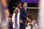 In this photo taken Oct. 10, 2019, Sacramento Kings head coach Luke Walton and Kings guard Buddy Hield watches the action during the second half of an NBA preseason basketball game against the Phoenix Suns in Sacramento, Calif. Hield, who was acquired when the Kings sent DeMarcus Cousins to the New Orleans Pelicans, led the team in scoring last season averaging 20.7 points per game. (AP Photo/Rich Pedroncelli)