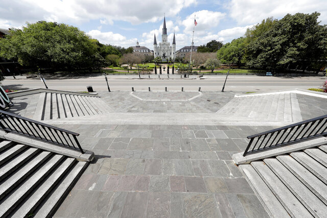 Jackson Square, normally bustling with tourists, is seen deserted in the French Quarter of New Orleans, due to the new coronavirus pandemic, Friday, March 27, 2020. While rich in history and culture, New Orleans is economically poor, and the people here are not necessarily well-positioned to weather this latest storm. (AP Photo/Gerald Herbert)