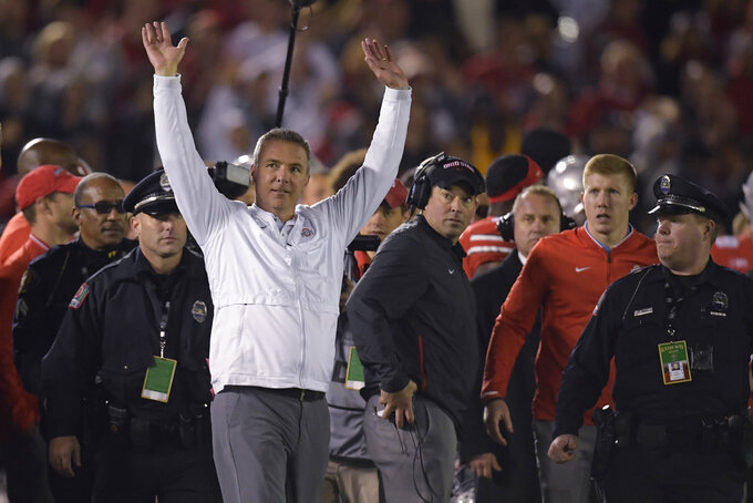 Ohio State coach Urban Meyer celebrates the team's 28-23 win over Washington during the Rose Bowl NCAA college football game Tuesday, Jan. 1, 2019, in Pasadena, Calif. (AP Photo/Mark J. Terrill)