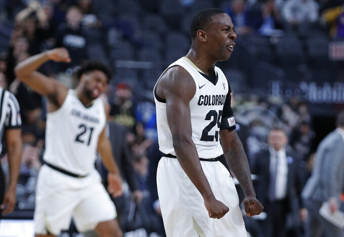 Colorado's McKinley Wright IV celebrates after a play against California during the first half of an NCAA college basketball game in the first round of the Pac-12 men's tournament Wednesday, March 13, 2019, in Las Vegas. (AP Photo/John Locher)