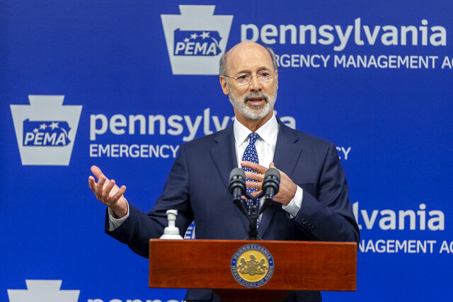 Pennsylvania Gov. Tom Wolf meets with the media at The Pennsylvania Emergency Management Agency (PEMA) headquarters, Friday, May 29, 2020 in Harrisburg, Pa. (Joe Hermitt/The Patriot-News via AP)