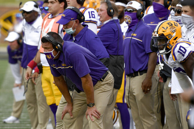 LSU head coach Ed Ogeron watches his team as his team fails to score a touchdown in the final seconds of their 45-41 loss to Missouri during second half of an NCAA college football game Saturday, Oct. 10, 2020, in Columbia, Mo. (AP Photo/L.G. Patterson)