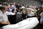 People attend the funeral of 17 year old Rina Shnerb, in Lod, Israel, Friday, Aug. 23, 2019. Shnerb has died of wounds from an explosion in the West Bank that the Israeli military has described as a Palestinian attack. (AP Photo/Sebastian Scheiner)