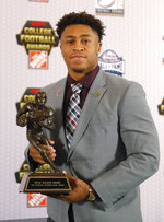 Wisconsin's Jonathan Taylor poses with the trophy after winning the Doak Walker Award as top running back in college football, Thursday, Dec. 6, 2018, in Atlanta. (AP Photo/John Bazemore)