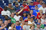 Fans react to a bat that slipped free from Chicago Cubs' Matt Duffy during the third inning of a baseball game against the Philadelphia Phillies, Wednesday, Sept. 15, 2021, in Philadelphia. (AP Photo/Matt Slocum)