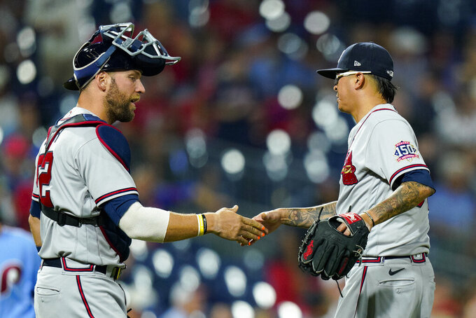 Atlanta Braves catcher Kevan Smith, left, celebrates a win with relief pitcher Jesse Chavez, right, during the ninth inning of a baseball game against the Philadelphia Phillies, Thursday, July 22, 2021, in Philadelphia. (AP Photo/Chris Szagola)