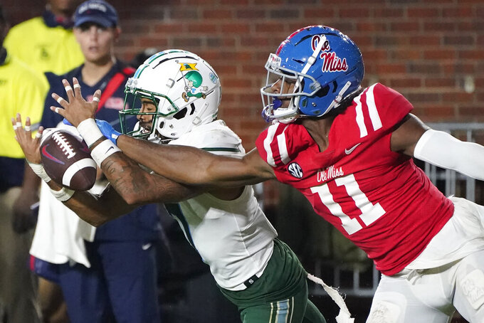 Tulane defensive back Lance Robinson (7) breaks up a pass to Mississippi wide receiver Dontario Drummond (11) during the first half of an NCAA college football game, Saturday, Sept. 18, 2021, in Oxford, Miss. (AP Photo/Rogelio V. Solis)