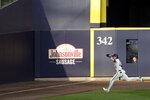Milwaukee Brewers' Christian Yelich catches a fly ball during the sixth inning of the first baseball game of a doubleheader against the Cincinnati Reds, Thursday, Aug. 27, 2020, in Milwaukee. (AP Photo/Aaron Gash)