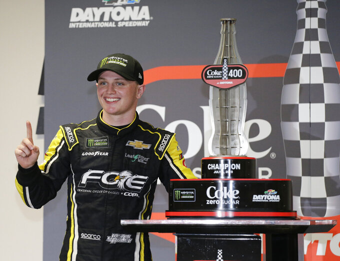 Justin Haley poses for photos with his trophy after winning a NASCAR Cup Series auto race at Daytona International Speedway, Sunday, July 7, 2019, in Daytona Beach, Fla. (AP Photo/Terry Renna)