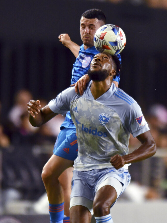 D.C. United defender Donovan Pines, front, and Inter Miami midfielder Lewis Morgan go for a head ball during the first half of an MLS soccer match Saturday, May 29, 2021, in Fort Lauderdale, Fla. (AP Photo/Jim Rassol)