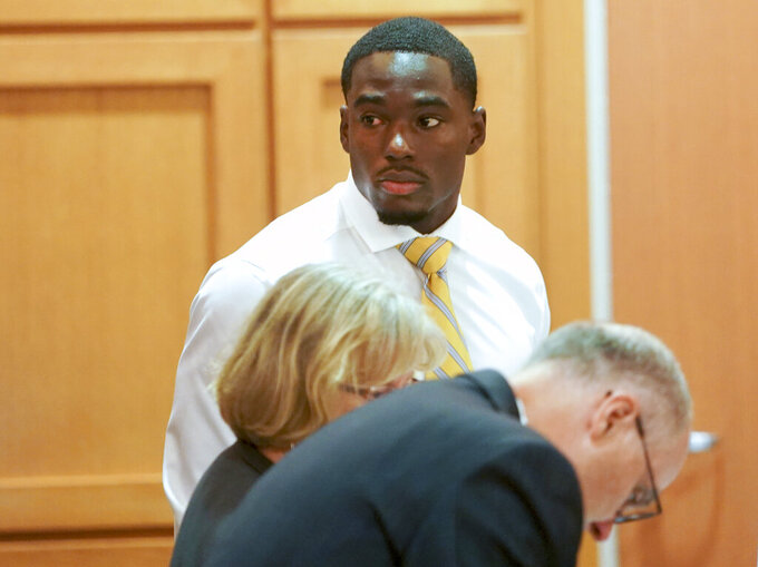 In this Tuesday, July 30, 2019 photo, former University of Wisconsin football player Quintez Cephus watches during his sexual assault trial at the Dane County Courthouse in Madison, Wis. The 21-year-old Cephus is charged with second- and third-degree sexual assault after two 18-year-old women reported to police that he had assaulted them on the same night in April 2018.(Steve Apps/Wisconsin State Journal via AP)