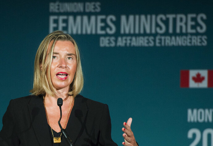 In this Saturday, Sept. 22, 2018, file photo, European Union foreign policy chief Federica Mogherini speaks at a news conference during a meeting of Women Foreign Ministers in Montreal. Five world powers and Iran agreed late Monday, Sept. 24, 2018, to establish a financial facility in the European Union to facilitate payments for Iranian imports and exports including oil, a key move sought by Tehran following the U.S. pullout from the 2015 nuclear deal and its re-imposition of sanctions. Mogherini told reporters after the closed-door ministerial meeting that the financial facility is also aimed at preserving the nuclear agreement. (Graham Hughes/The Canadian Press via AP)