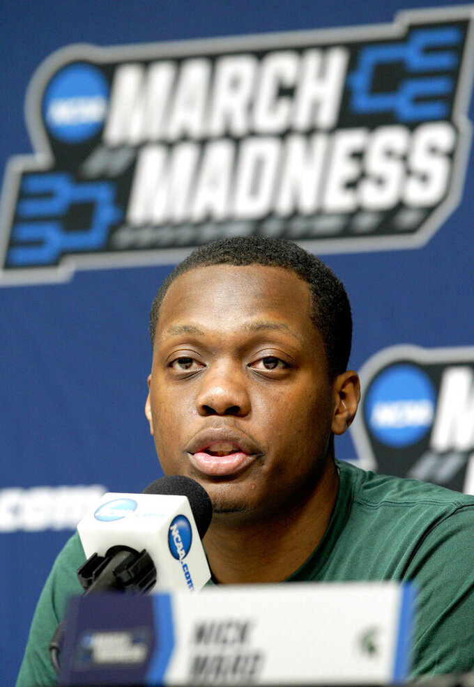 Michigan State's Cassius Winston speaks during a news conference in Des Moines, Iowa, Friday, March 22, 2019, ahead of their second round men's college basketball game against Minnesota in the NCAA Tournament. (AP Photo/Nati Harnik)