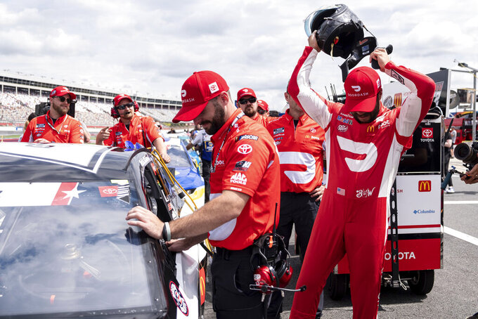 Bubba Wallace puts his helmet on for his qualifying run for the NASCAR Cup Series auto race at Charlotte Motor Speedway on Saturday, May 29, 2021 in Charlotte, N.C. (AP Photo/Ben Gray)