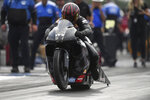 In this photo provided by the NHRA, Pro Stock Motorcycle veteran Eddie Krawiec powers his way to take the provisional No. 1 spot at the NHRA U.S. Nationals drag races at Lucas Oil Raceway in Brownsburg, Ind., Friday, Sept. 3, 2021. (Marc Gewertz/NHRA via AP)