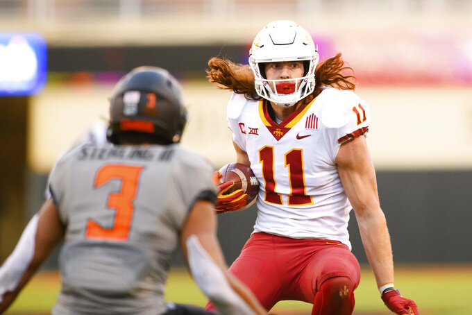 Iowa State tight end Chase Allen (11) runs toward Oklahoma State safety Tre Sterling (3) in the final minutes of an NCAA college football game Saturday, Oct. 24, 2020, in Stillwater, Okla. (AP Photo/Brody Schmidt)