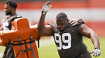 Cleveland Browns defensive tackle Andrew Billings runs a drill during an NFL football practice, Saturday, July 31, 2021, in Berea, Ohio. (AP Photo/Tony Dejak)