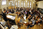 In this Oct. 21, 2019, photo, conductor David Shipps, front left, directs the orchestra during the recording of a video game soundtrack in Nashville, Tenn. Music City is earning a new reputation as Soundtrack City. And more production companies, including Netflix, Showtime, Sony and Focus Features, have been lured to Nashville to record music for movies, TV and video games in the last year thanks to a new incentive program. (AP Photo/Mark Humphrey)