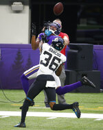 Minnesota Vikings wide receiver Justin Jefferson, rear, catches a pass ahead of Jacksonville Jaguars cornerback Luq Barcoo (36) during the second half of an NFL football game, Sunday, Dec. 6, 2020, in Minneapolis. (AP Photo/Bruce Kluckhohn)
