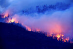 The Creek Fire burns along a hillside in the Cascadel Woods community of Madera County, Calif., on Monday, Sept. 7, 2020. (AP Photo/Noah Berger)