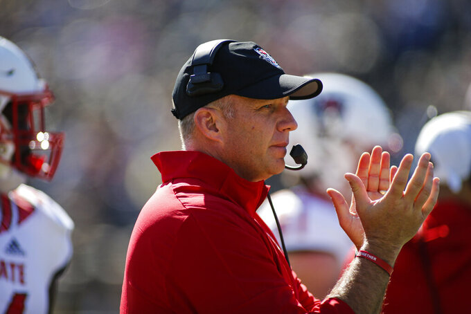 North Carolina State Wolfpack head coach Dave Doeren watches his team play Wake Forest in the first half of an NCAA college football game in Winston-Salem, N.C., Saturday, Nov. 2, 2019. Wake Forest won 44-10. (AP Photo/Nell Redmond)