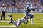 North Carolina running back Ty Chandler (19) is tackled by Virginia defensive back Coen King (9) during the second half of an NCAA college football game in Chapel Hill, N.C., Saturday, Sept. 18, 2021. (AP Photo/Gerry Broome)