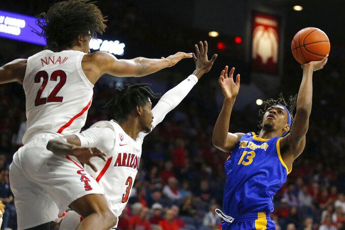 San Jose State guard Seneca Knight (13) shoots over Arizona's Dylan Smith (3) and Zeke Nnaji (22) during the first half of an NCAA college basketball game Thursday, Nov. 14, 2019, in Tucson, Ariz. (AP Photo/Rick Scuteri)