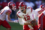Utah quarterback Charlie Brewer (12) looks to hand off the ball during the first half of an NCAA college football game against San Diego State Saturday, Sept. 18, 2021, in Carson, Calif. (AP Photo/Ashley Landis)