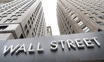 Buildings line Wall Street, Monday, Aug. 31, 2020, in New York. (AP Photo/Mark Lennihan)
