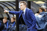 """FILE - England coach Phil Neville instructs his team against France during the first half of a SheBelieves Cup women's soccer match in Columbus, Ohio, in this Thursday, March 1, 2018, file photo. David Beckham bristled when asked whether Phil Neville's was hired as Inter Miami coach because they're buddies. """"Of course, people are always going to turn around and say, oh, it's because he's your friend. It's nothing to do with him being my friend,"""" Beckham said Friday, Jan. 22, 2021. (AP Photo/Jay LaPrete, FIle)"""