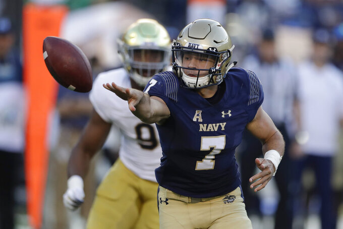 Navy quarterback Garret Lewis tosses the ball during the first half of an NCAA college football game against Notre Dame Saturday, Oct. 27, 2018, in San Diego. (AP Photo/Gregory Bull)