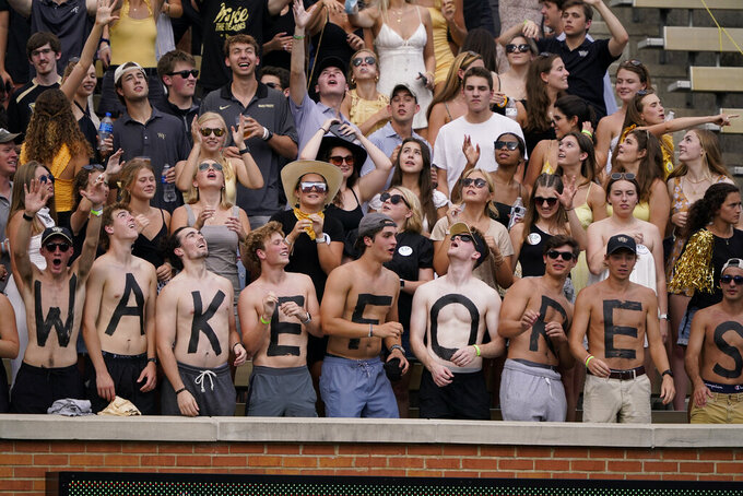 Wake Forest fans cheer during the first half of the team's NCAA college football game against Florida State on Saturday, Sept. 18, 2021, in Winston-Salem, N.C. (AP Photo/Chris Carlson)