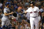 Boston Red Sox's Christian Vazquez, right, reacts beside Los Angeles Dodgers' Austin Barnes after striking out swinging during to end the sixth inning of a baseball game in Boston, Saturday, July 13, 2019. (AP Photo/Michael Dwyer)