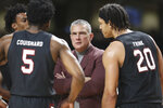 South Carolina head coach Frank Martin talks to Jermaine Couisnard (5) and Alanzo Frink (20) in the second half of an NCAA college basketball game against Vanderbilt Saturday, March 7, 2020, in Nashville, Tenn. (AP Photo/Mark Humphrey)
