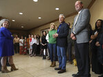 Jon Huntsman Jr., second from right, and his wife Mary Kaye talk with employees and clients at KKOS Lawyers and K&E CPAs in their offices in Cedar City, Utah, shortly after announcing that he is running for a third term as Utah's governor Thursday, Nov. 14, 2019. (Steve Griffin/The Deseret News via AP)