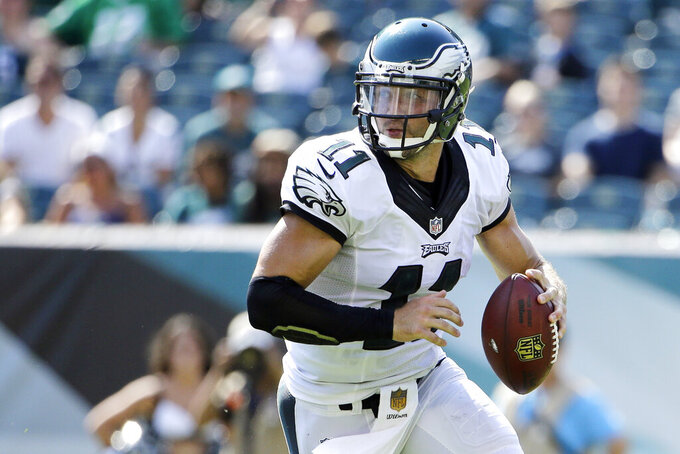 FILE - In this Aug. 16, 2015, file photo, Philadelphia Eagles' Tim Tebow looks to pass during the second half of a preseason NFL football game against the Indianapolis Colts in Philadelphia. Tebow and coach Urban Meyer are together again, this time in the NFL and with Tebow playing a new position. The former Florida star and 2007 Heisman Trophy-winning quarterback signed a one-year contract with the Jacksonville Jaguars on Thursday, May 20, 2021, and will attempt to revive his pro career as a tight end. (AP Photo/Matt Rourke, File)