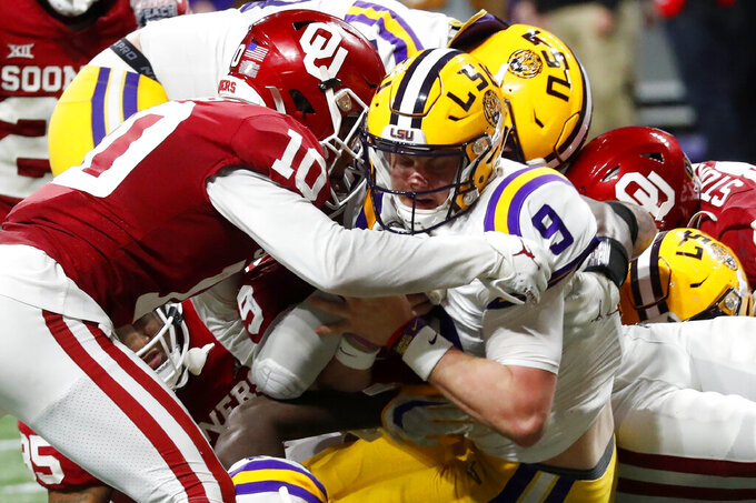 LSU quarterback Joe Burrow (9) runs into the end zone for a touchdown against Oklahoma during the second half of the Peach Bowl NCAA semifinal college football playoff game, Saturday, Dec. 28, 2019, in Atlanta. (AP Photo/John Bazemore)