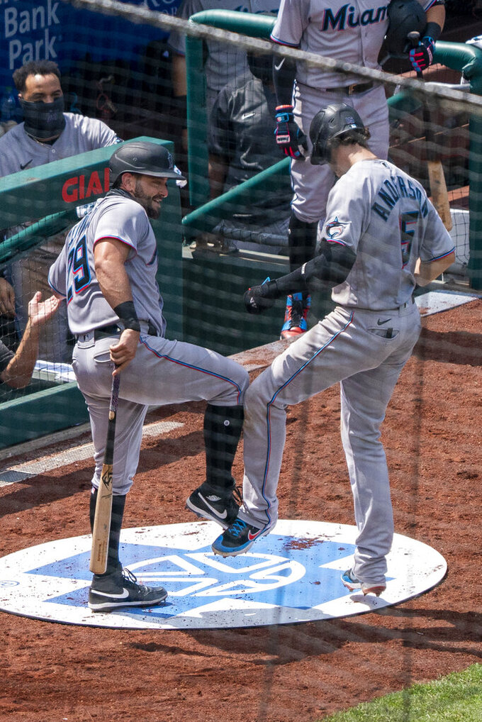 Miami Marlins' Brian Anderson, right, celebrates his two-run home run with Francisco Cervelli, left, during the fifth inning of a baseball game against the Philadelphia Phillies, Sunday, July 26, 2020, in Philadelphia. (AP Photo/Chris Szagola)